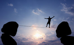 man-balancing-rope-highline-walker-blue-sky-two-rocks-concept-risk-taking-challenge-56927530